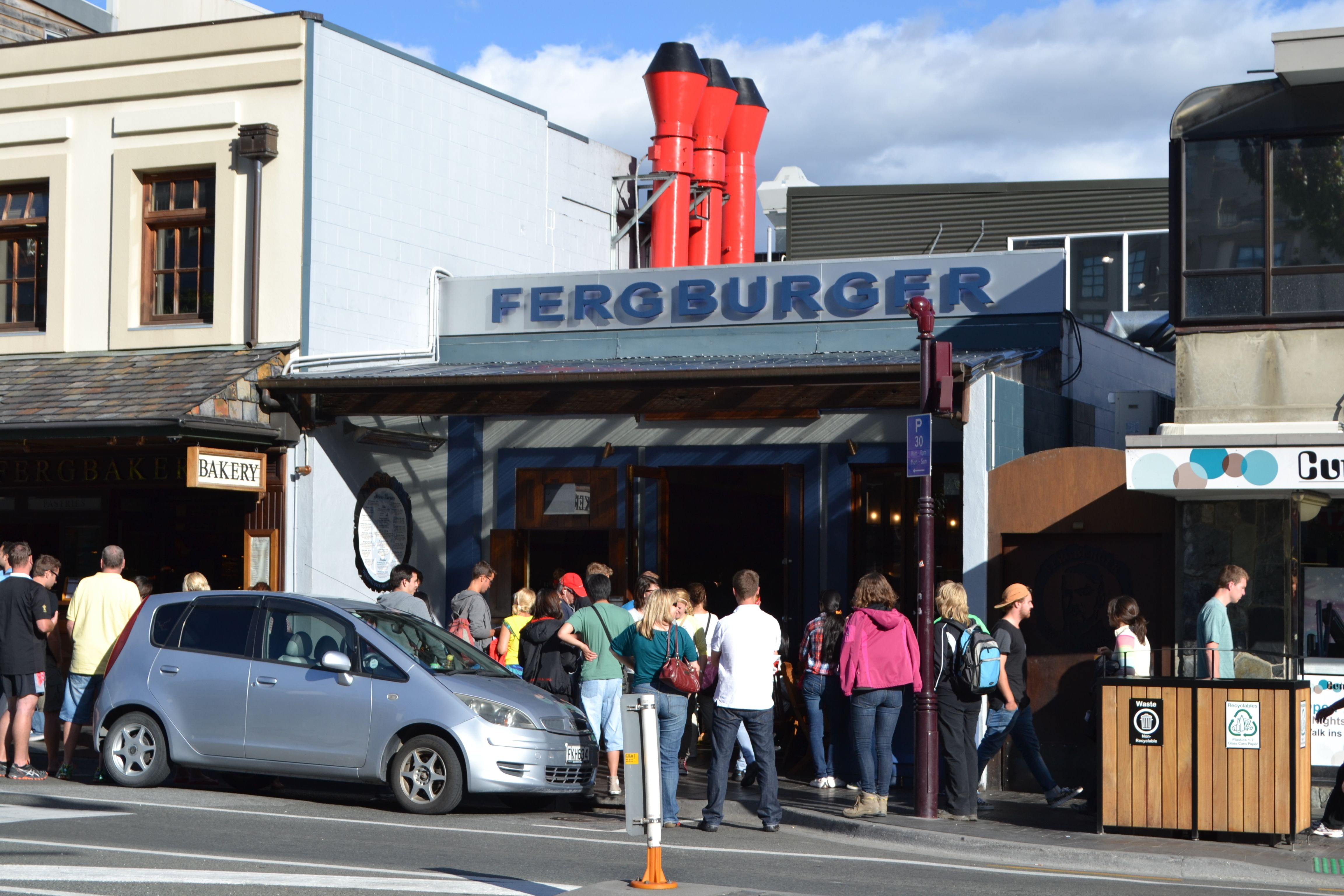 Lining up for the infamous Fergburger in Queenstown.