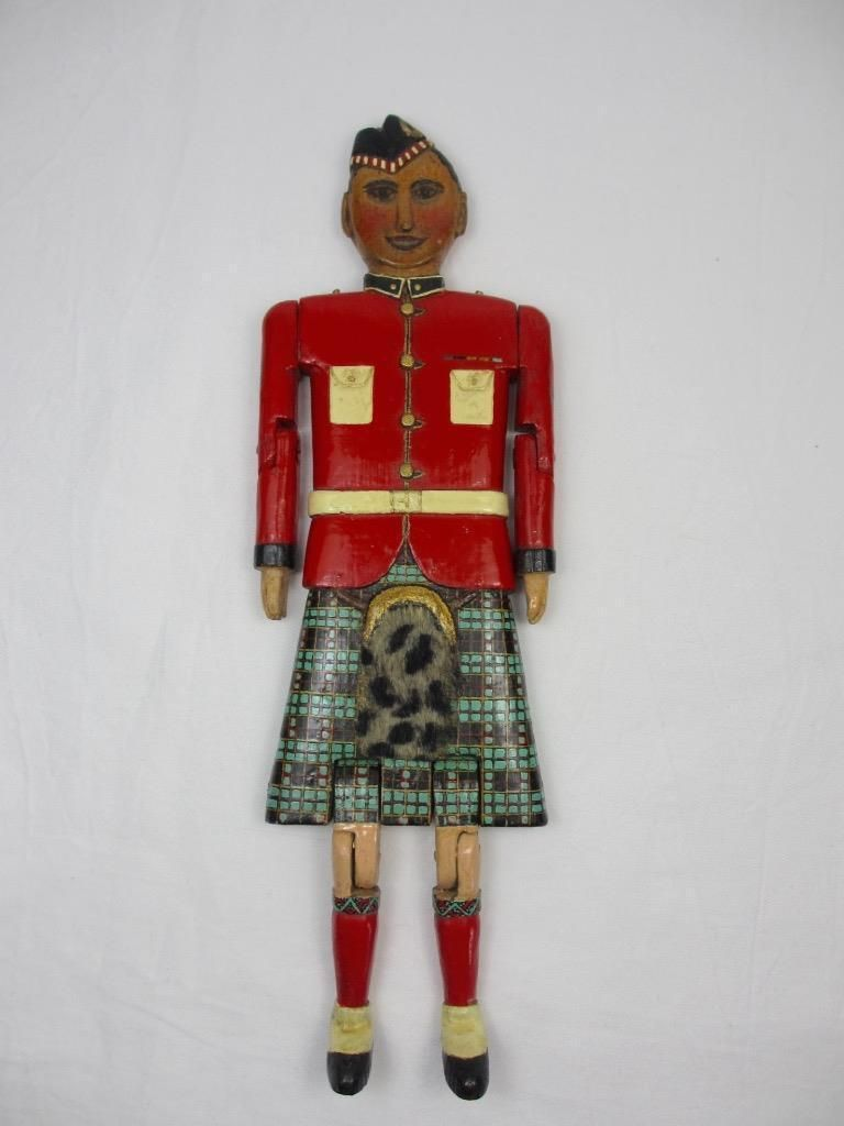 DATING TO THE LATE 19TH CENTURY AND CARVED IN PINE THIS IS A VERY RARE EXAMPLE OF AN ARTICULATED DOLL IN THE FORM OF A BRITISH SOLDIER FROM ONE OF THE SCOTTISH REGIMENTS. WITH MUCH OF THE DETAIL CARVED IN RELIEF AND WONDERFUL PAINTING AND HIGHLIGHTS HE IS WEARING A KILT WITH MATCHING SOCKS. | eBay!