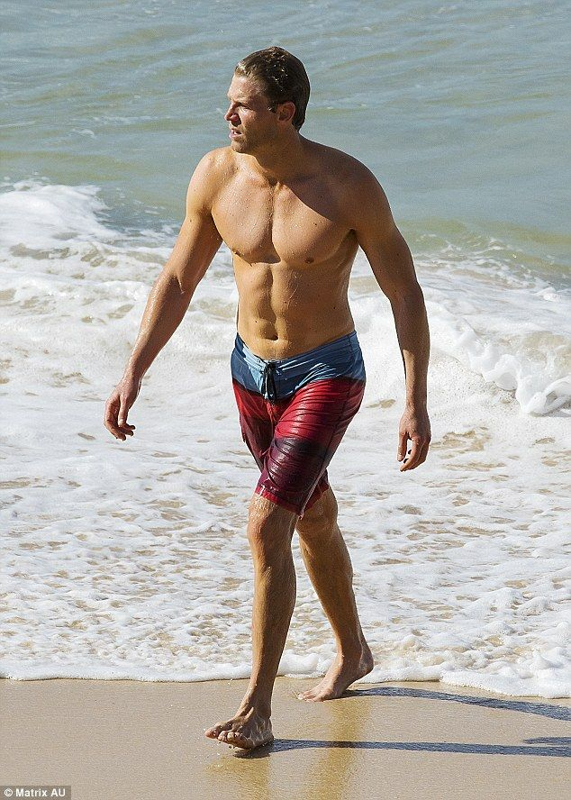 Day off: Dr. Chris Brown hit Bondi beach on Saturday  TYPICAL AUSSIE MALE- LOL SERIOUSLY, HE IS PERFECT, A VET, SWEET, KIND, ADONIS