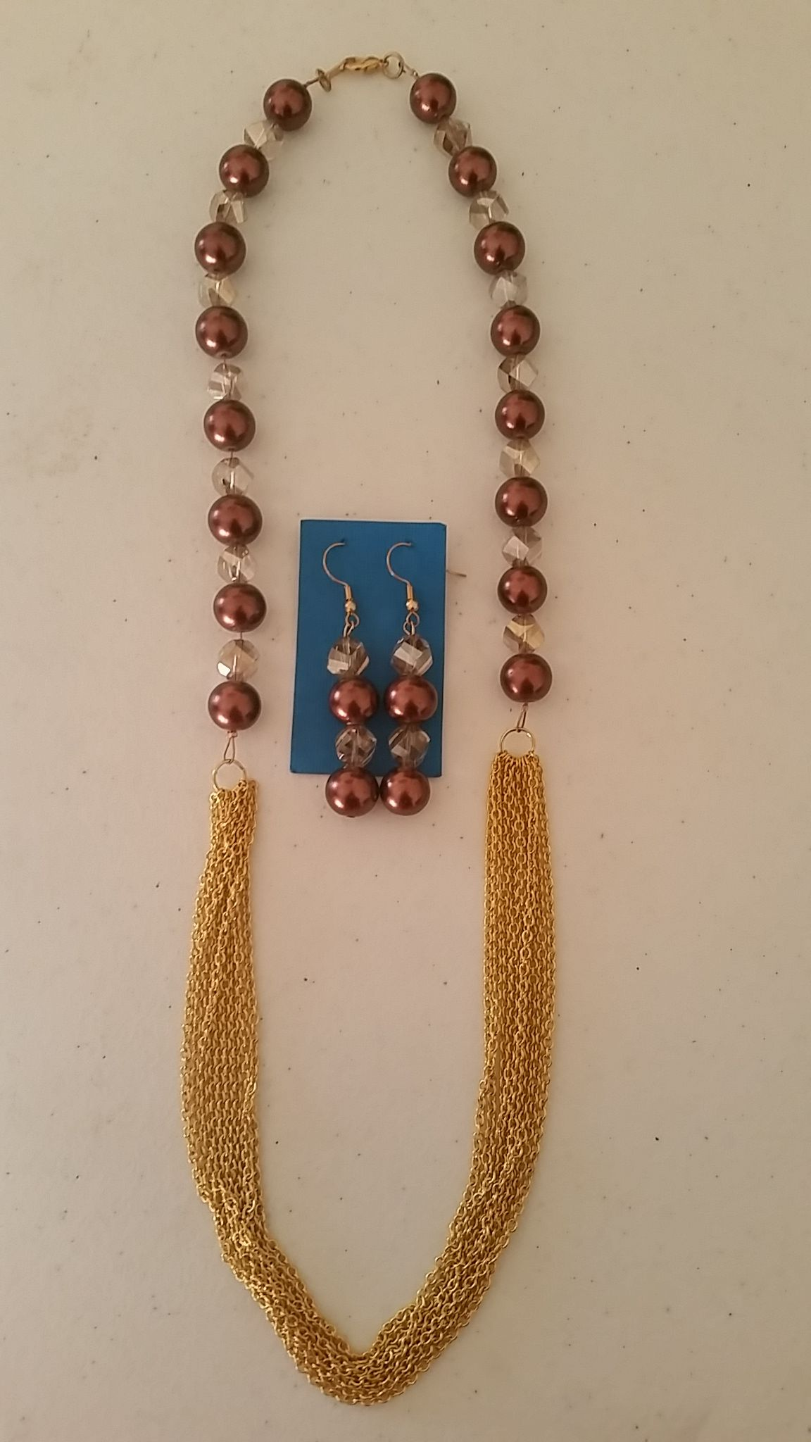 Brown Pearls and golden chain necklace with matching earrings