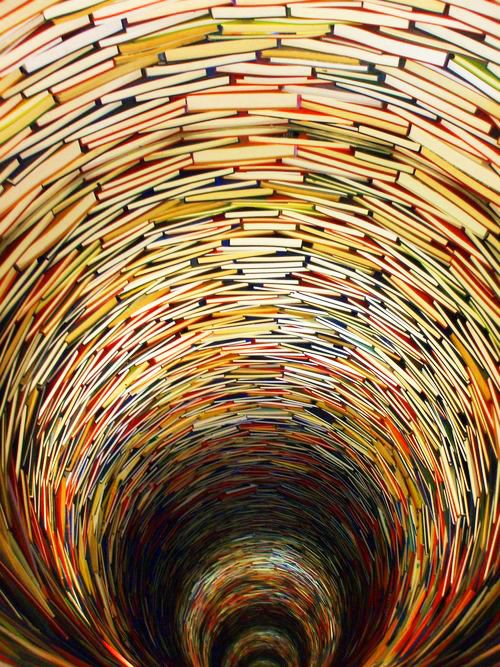 The Prague Municipal Library at Marianske Square, Prague, Czech Republic is definitely worth visiting because of an amazing sculpture made of numerous books by Matej Kren, a young Czechoslovak artist. This wonderful sculpture is placed in the Prague Municipal Library, consisting of books and mirrors, creating an unusual effect of infinity.