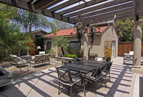 forget the Spanish style for a second...and look at the patio living areas :)
