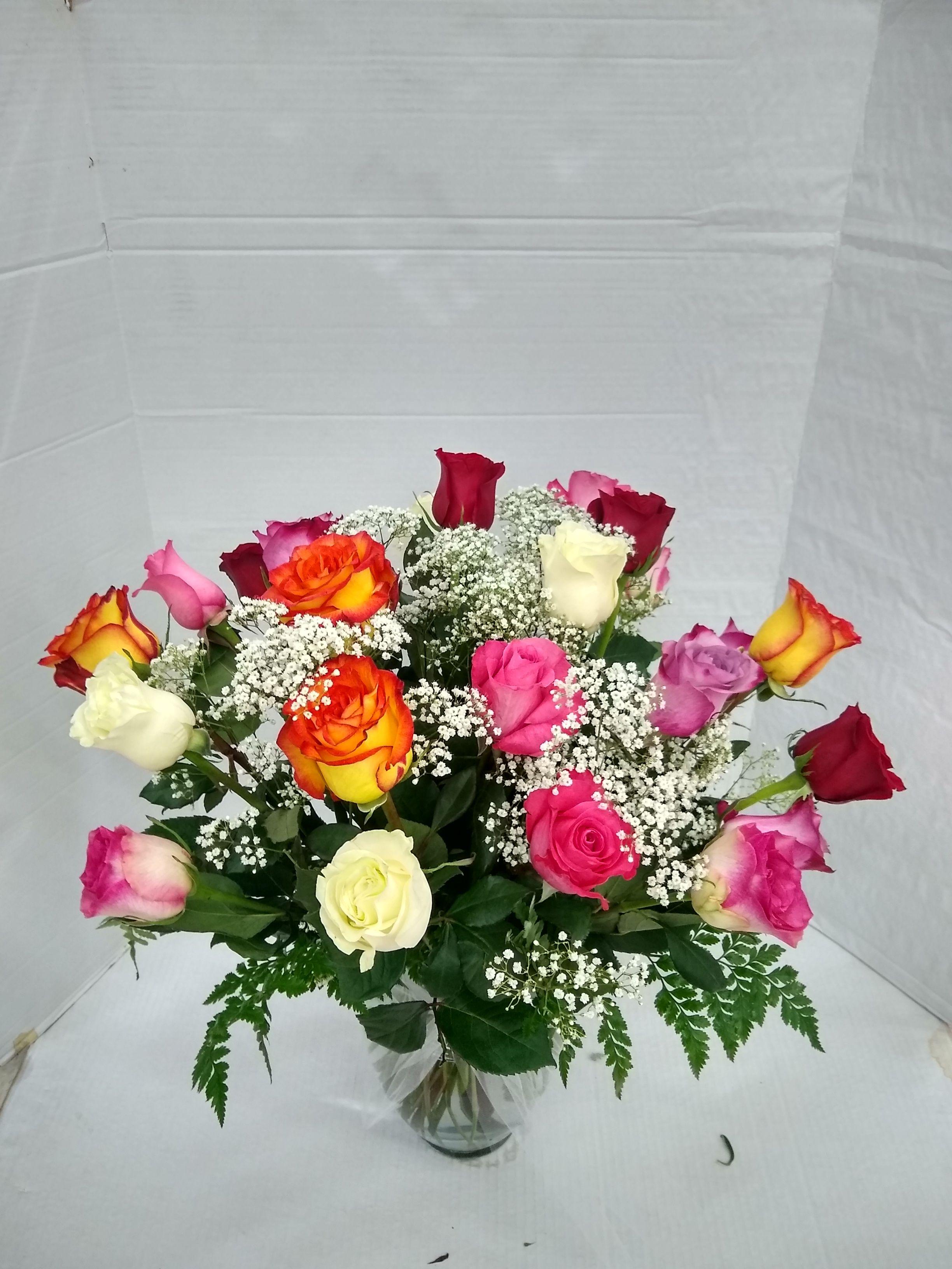 Beautiful mix colors roses in a crystal vase at estrellas