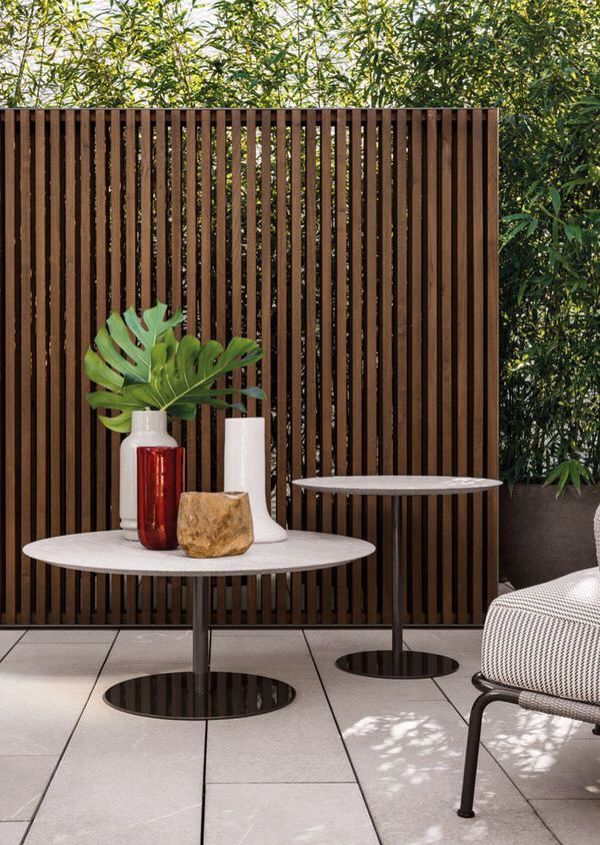 Narrow Vertical Timber Slat Screen For Privacy And A Division Of Space.