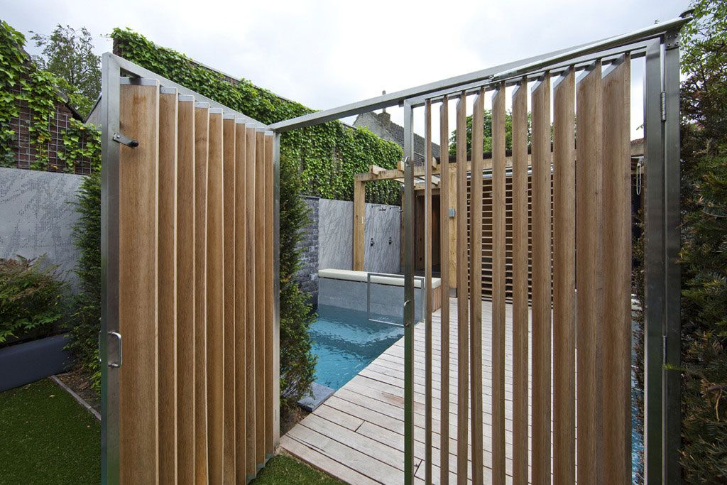 Innovative Vertical Wooden Fence Combined With Metal Trim Design Idea Feat  Small Backyard Pool And Climbing