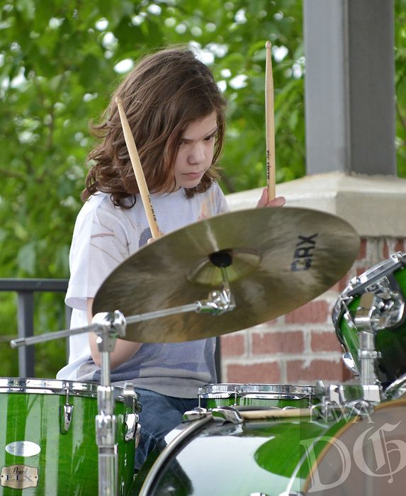 NWA Democrat-Gazette/BEN GOFF -- 05/15/15 Jack Daidone, 14, plays drums as Dean's List students from The School of Rock Rogers perform a set on the Frisco Stage in downtown Rogers on Friday May 15, 2015.