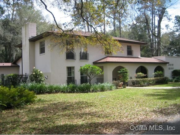WHAT A GREAT OPPORTUNITY TWO HOMES ON 2.58 ACRES IN CONVENIENT SE OCALA. MAIN HOME FEATURES A LIV RM, DIN RM, DEN W/FIREPLACE, FAM RM, LARGE EAT-IN KIT, 3 BEDRMS, 2 BATHS, 2 HALF BATHS, LAUNDRY RM, SCREENED PORCH OVERLOOKING LARGE POOL & BEAUTIFUL MATURE LANDSCAPING. ROOF & A/C 6-7 YRS OLD. SECOND HOME HAS LIV RM, EATING AREA, 2/2, FRONT PORCH, DBL GARAGE WITH ITS OWN DRIVEWAY & MATURE LANDSCAPING OFFERS PRIVACY TO BOTH HOMES. 2ND HOME COULD BE USED FOR GUESTS, A RENTAL, OR SOLD SEPARATELY.