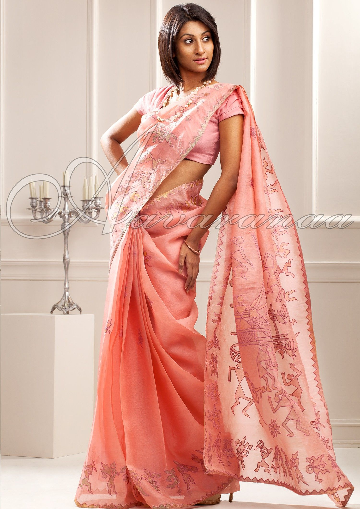 c522d6a277 Aavarnaa - A light pink organza saree with multicolor tissue appliquéd and  embroidered in the traditional worli design along the border and a creative  pallu