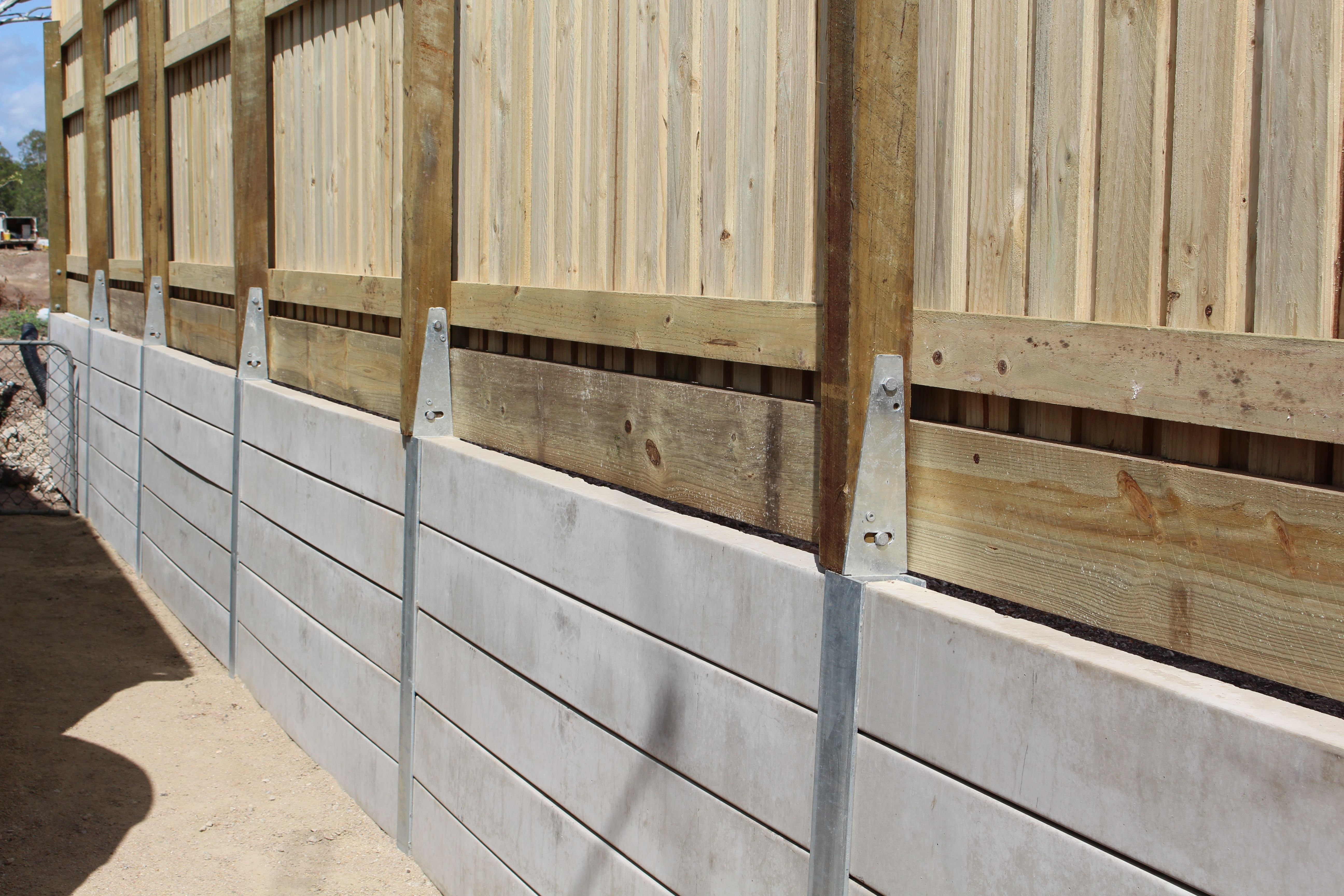 Pioneer Smooth Grey Concrete Sleeper Retaining Wall With A Timber Fence Attached Using Our Fence Brac Front Yard Fence Backyard Fences Concrete Retaining Walls