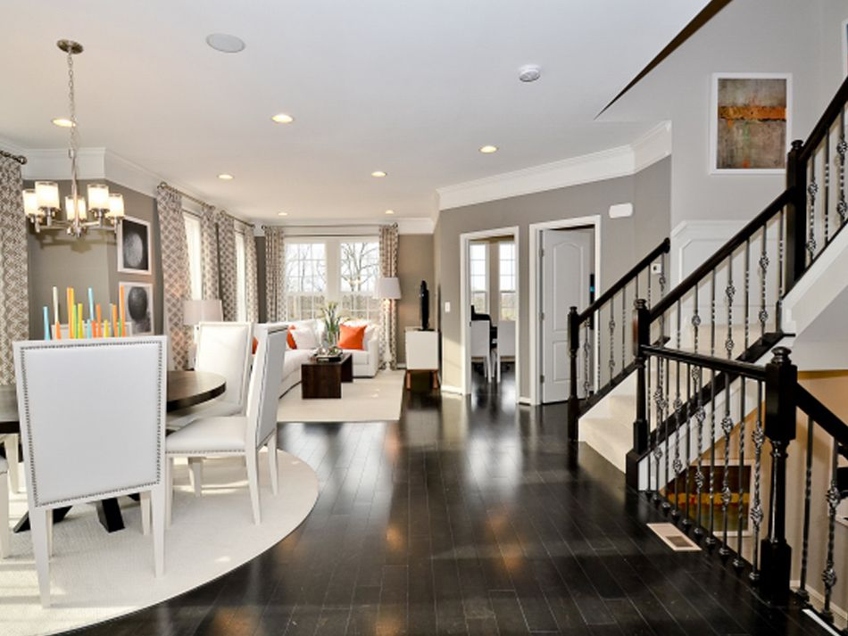 gray walls dark floor thick white trim kind of the overall look i