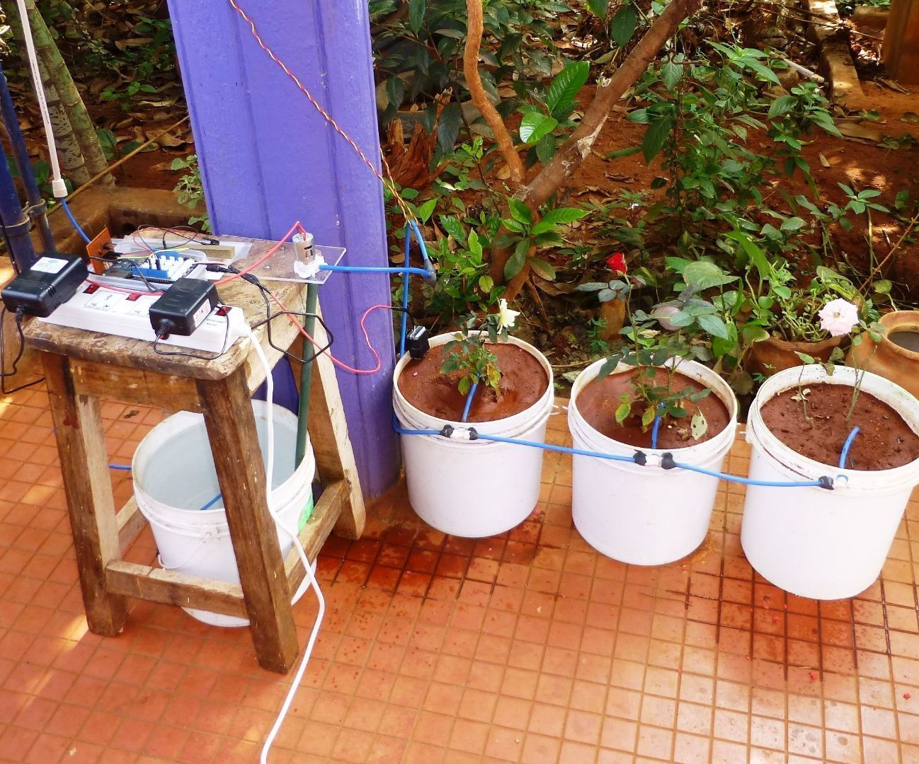 Automated Watering Of Potted Plants With Intel Edison Plants Diy Self Watering Planter Plant Watering System