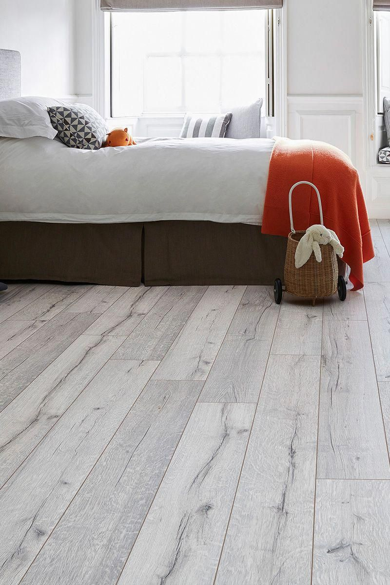 A Scandinavian Style White Wood Effect Floor That Offers Fantastic Value Series Woods Pr White Laminate Flooring White Wood Laminate Flooring Bedroom Flooring