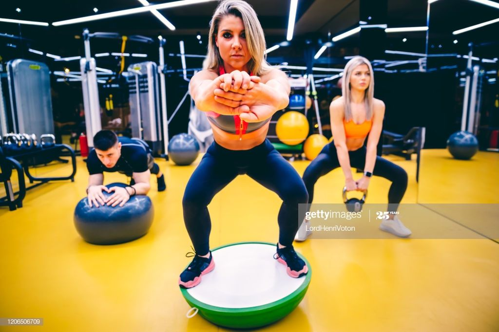 Group Of People Work Out At The Gym Together Gym Workout Ball Exercises