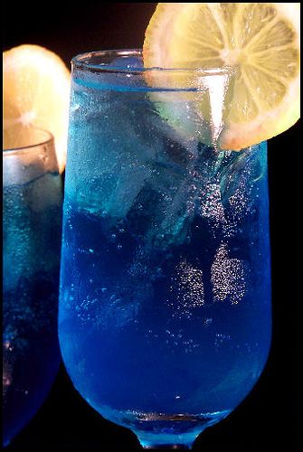 Electric Lemonade ~ 1 1/2 oz. Vodka or Rum, 1/2 oz. Blue Curacao, 2 oz. Sweet and Sour Mix, 7-Up or Sprite, and a Lemon Slice
