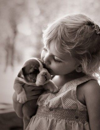 Kids and pets. Our dogs are certainly not this calm, but I love the idea of pictures of them together.