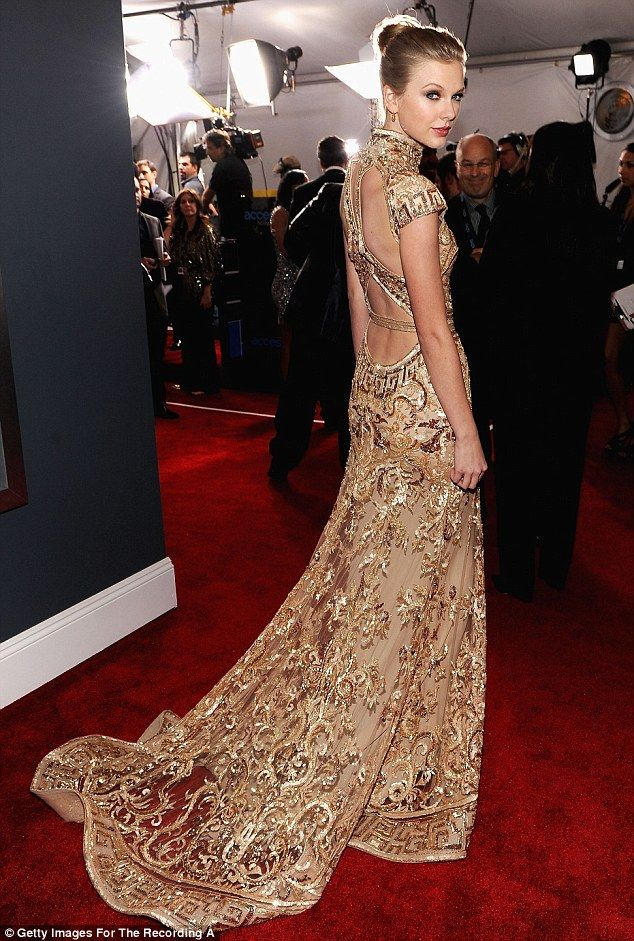 Golden girl! Revenge is sweet for Taylor Swift as she scoops two ...