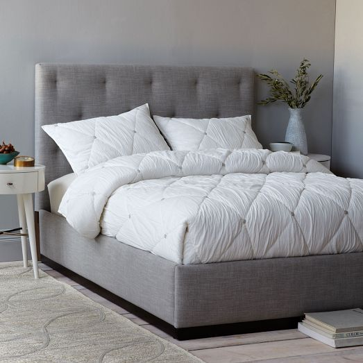 The Diamond Tufted Bed Mixes Staggered Tufting And An Exposed Wood