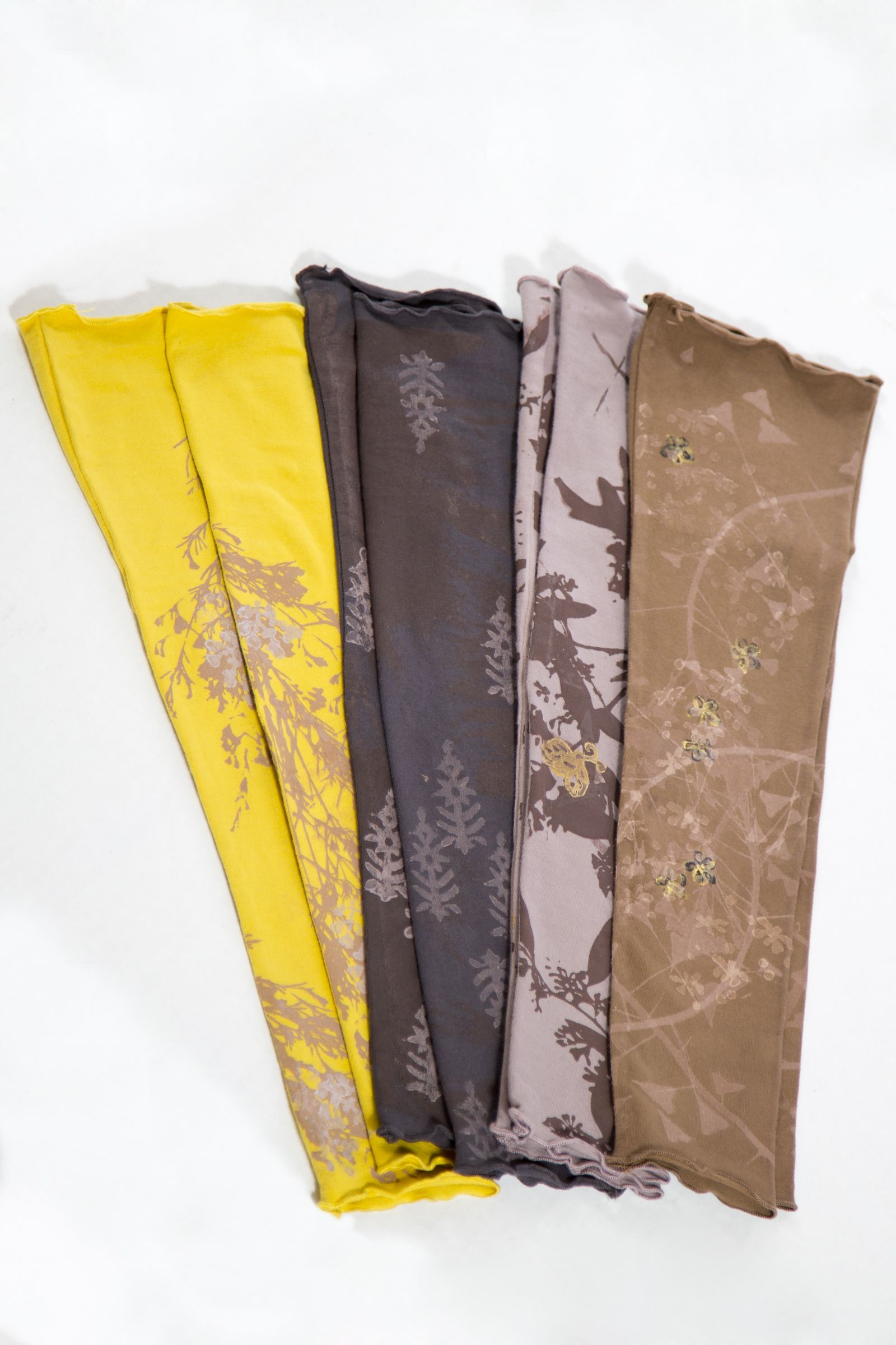 """(Pictured: primrose arm tubes.)  Basic """"how to"""" on this look.  1) start with top and bottom: a tank, tee,  legging. (tissue weight cotton, organic cotton, jersey)  2) midlayer - a shift, apron or skirt in a print. (linen or silk for texture.  3) cardi, vest, or light jacket. texture or a bold print or tone down with neutrals. 4) jacket or coat. 5) accessorize - belt, drape a scarf, dangle a handful of necklaces."""