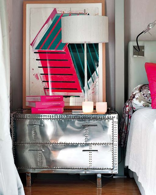 I LOVE a big bedside table... OBSESS over them.  Love the vintage metal wrapped chest with the modern pops of pink in the Artwork and the accessories