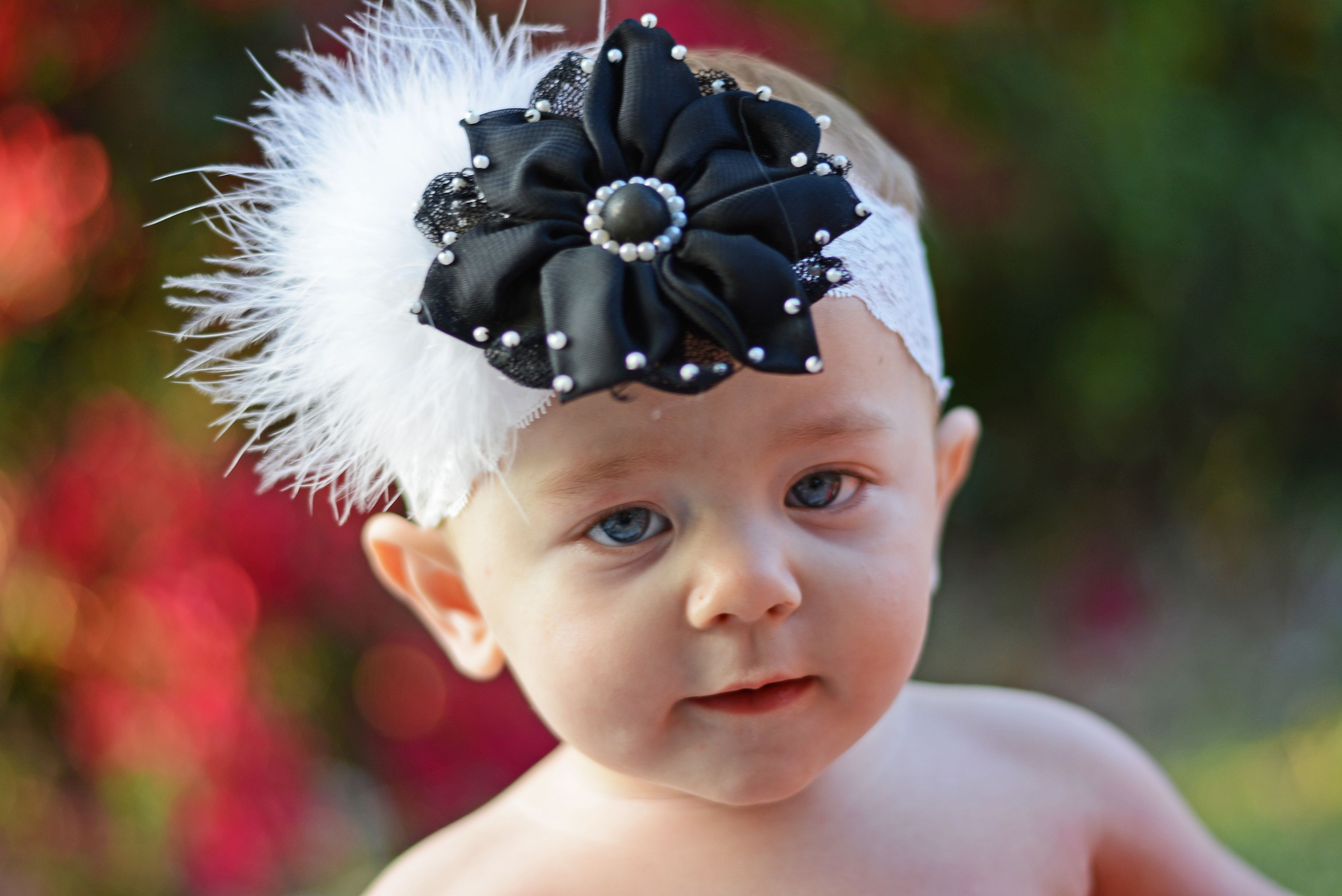 This beautiful black flower with pearls and maribou is perfect for this winter or any time of year!