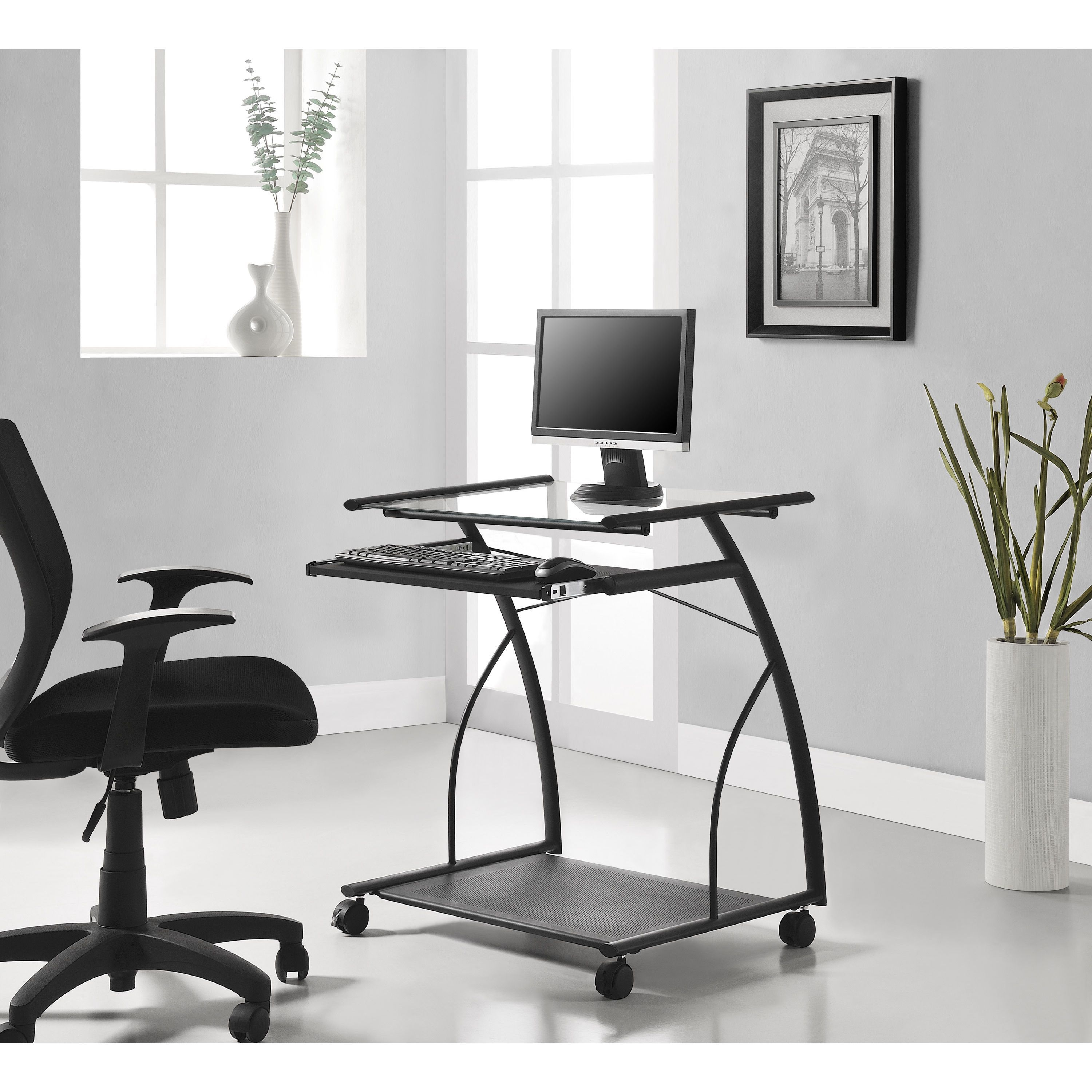 Sleek and space-saving, this smart computer desk features 4 wheels ...
