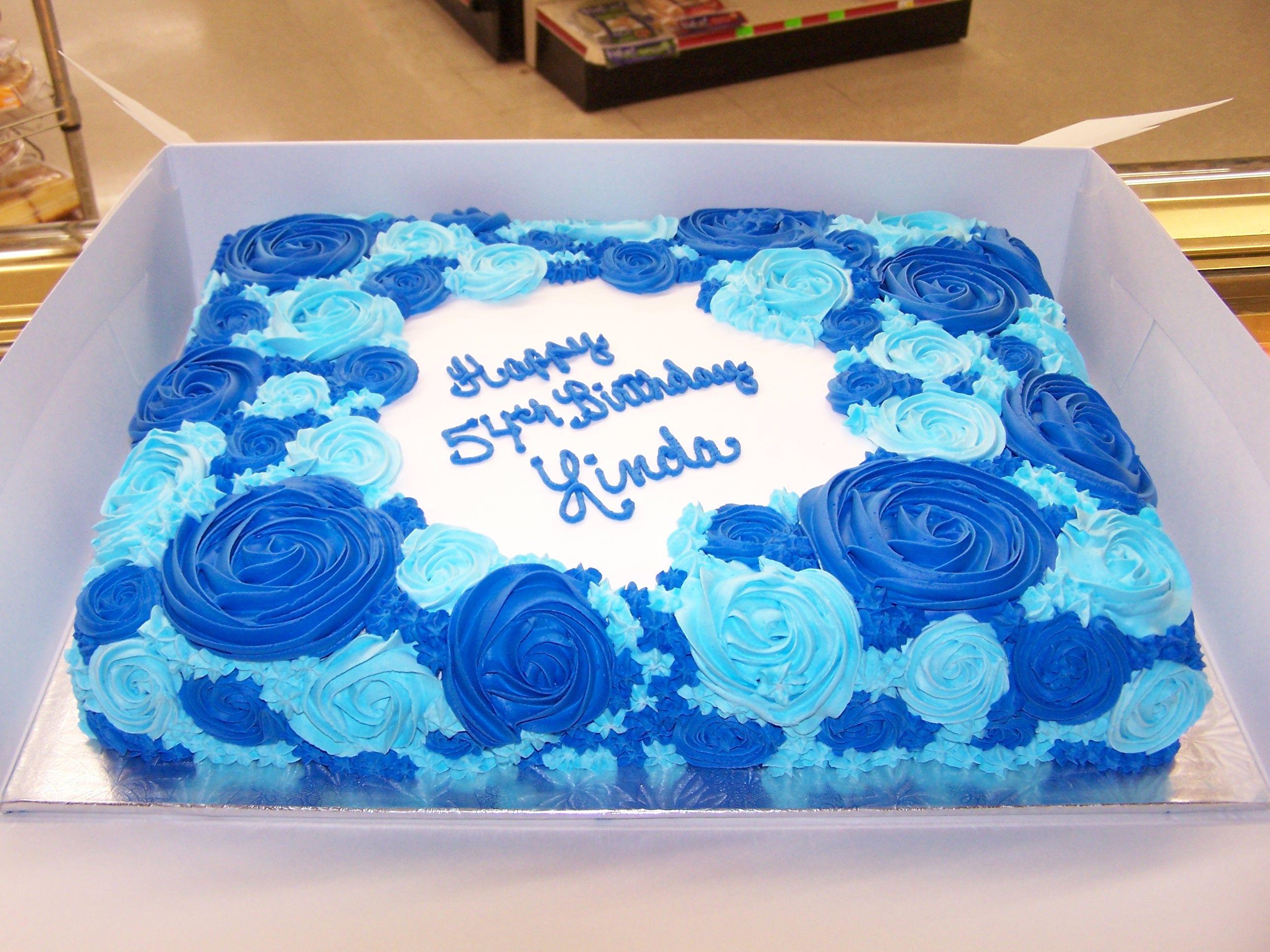 Dark Blue And Light Blue Rosette Cake