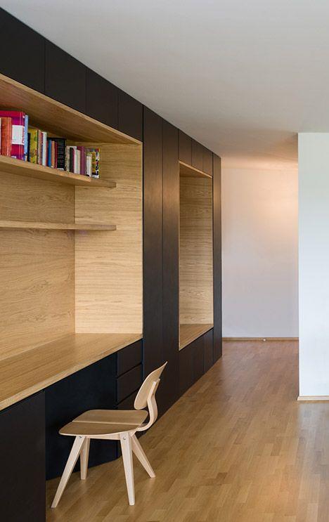 Wooden niches contain work surfaces and storage inside this - diseo de interiores de departamentos