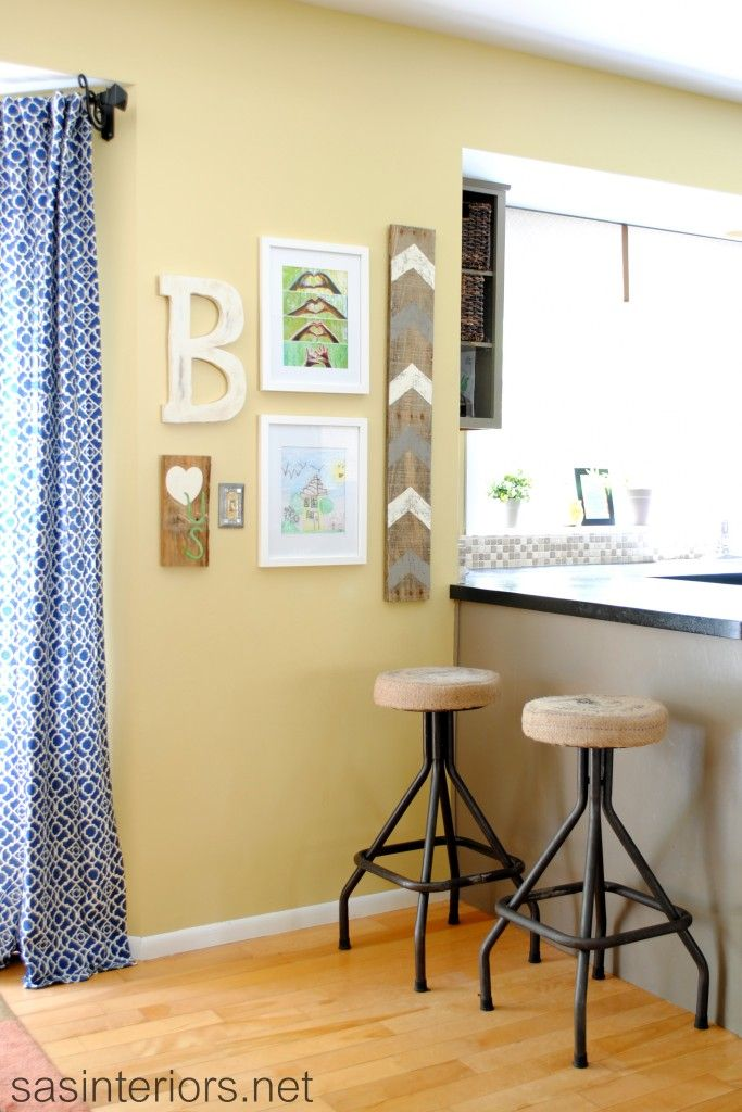 DIY gallery wall with a personal photography covering a phone jack ...