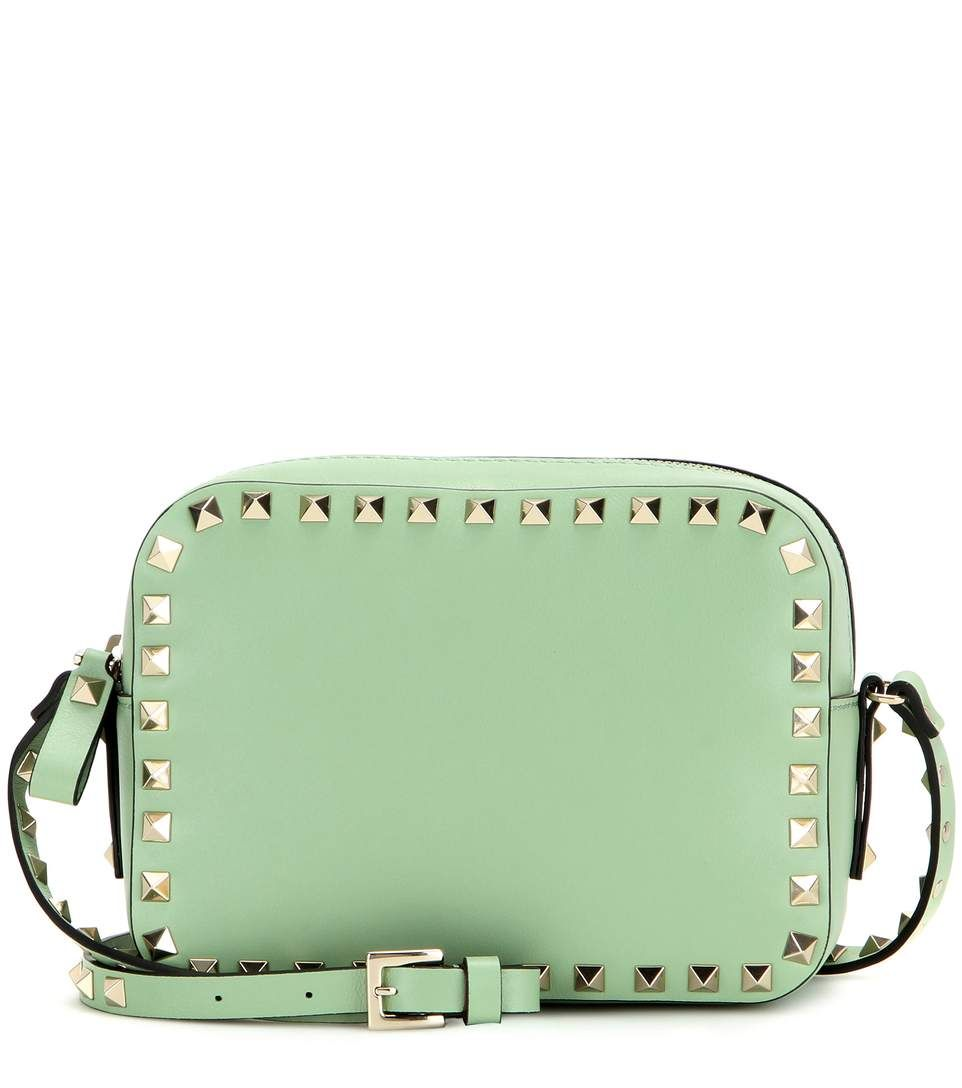 Valentino - Rockstud leather cross-body bag - Light green-hued leather finished with the label's iconic 'Rockstud' hardware makes for a modern and edgy fusion. - @ www.mytheresa.com