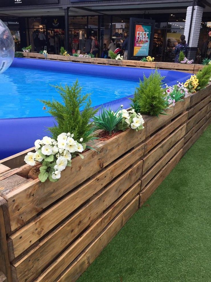 This Entire Swimming Pool Area Is Covered Or Enclosed With The Wood Pallet Pallet Pool Diy Swimming Pool Above Ground Pool Landscaping