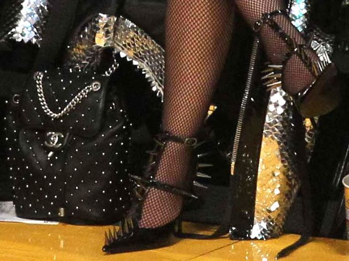 698000a7e7 Details of Nicki Minaj s Chanel studded leather backpack and Balenciaga   Knife  spiked t-strap pumps.