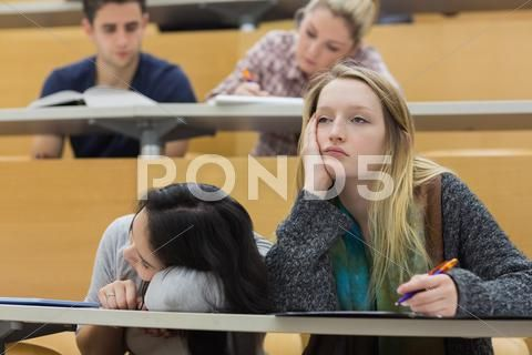 Demotivated students in a lecture hall Stock Photos ,#lecture#students#Demotivated#Photos