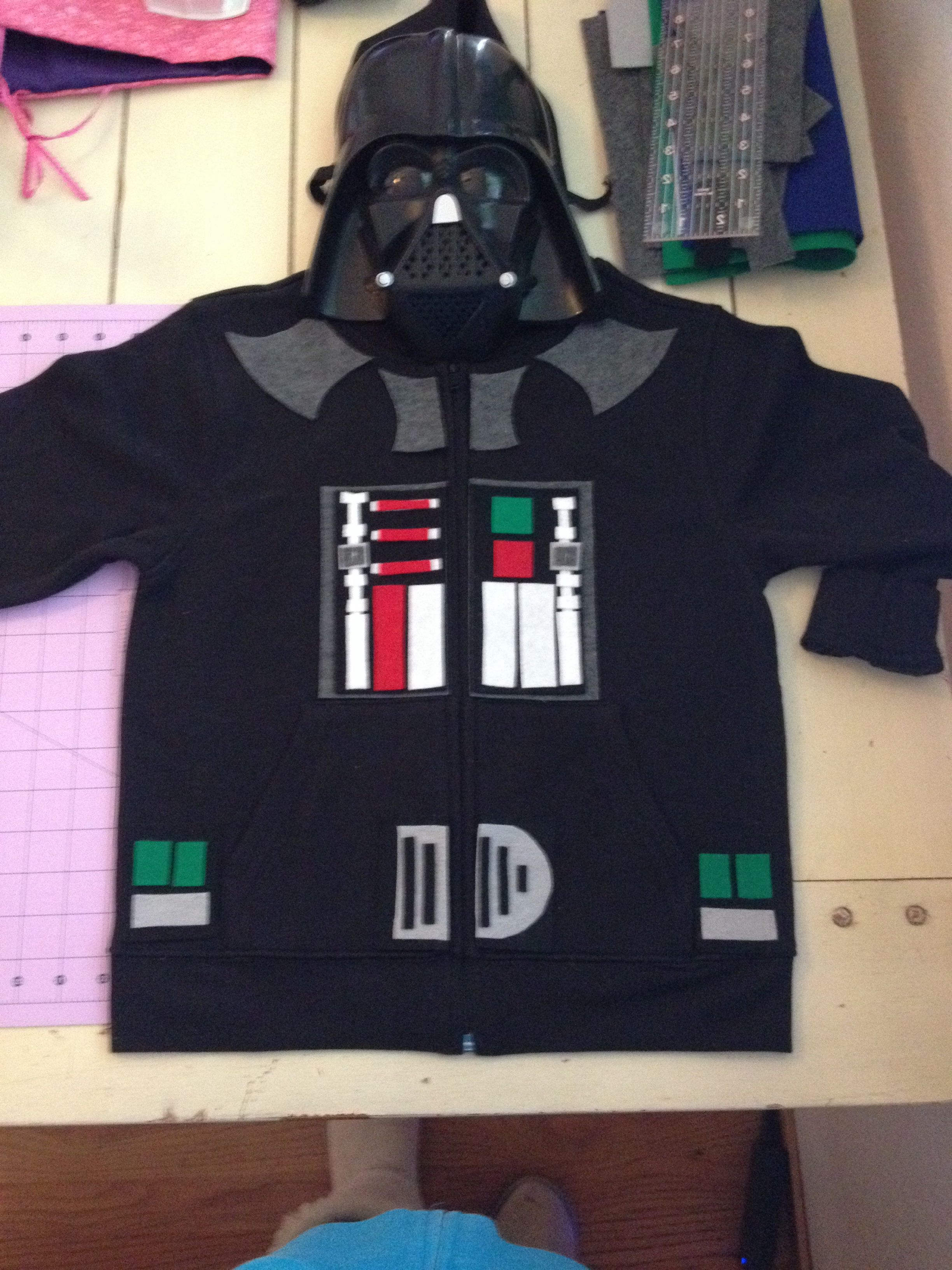 DIY Darth Vader Costume/Hoodie: $10 kid's Kmart hoodie, $2.00 Worth of felt from JoAnn's, Fabric Glue... Done! I sewed the pieces on for a little extra strength but the glue works well if you plan on only using the costume once or twice :)   #costume #DIY #Starwars #darthvader