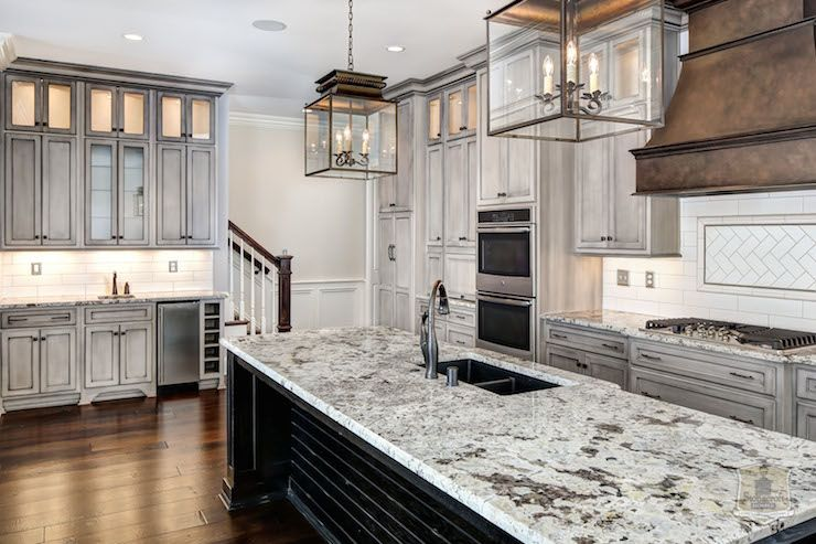 kitchen with distressed white cabinets black granite