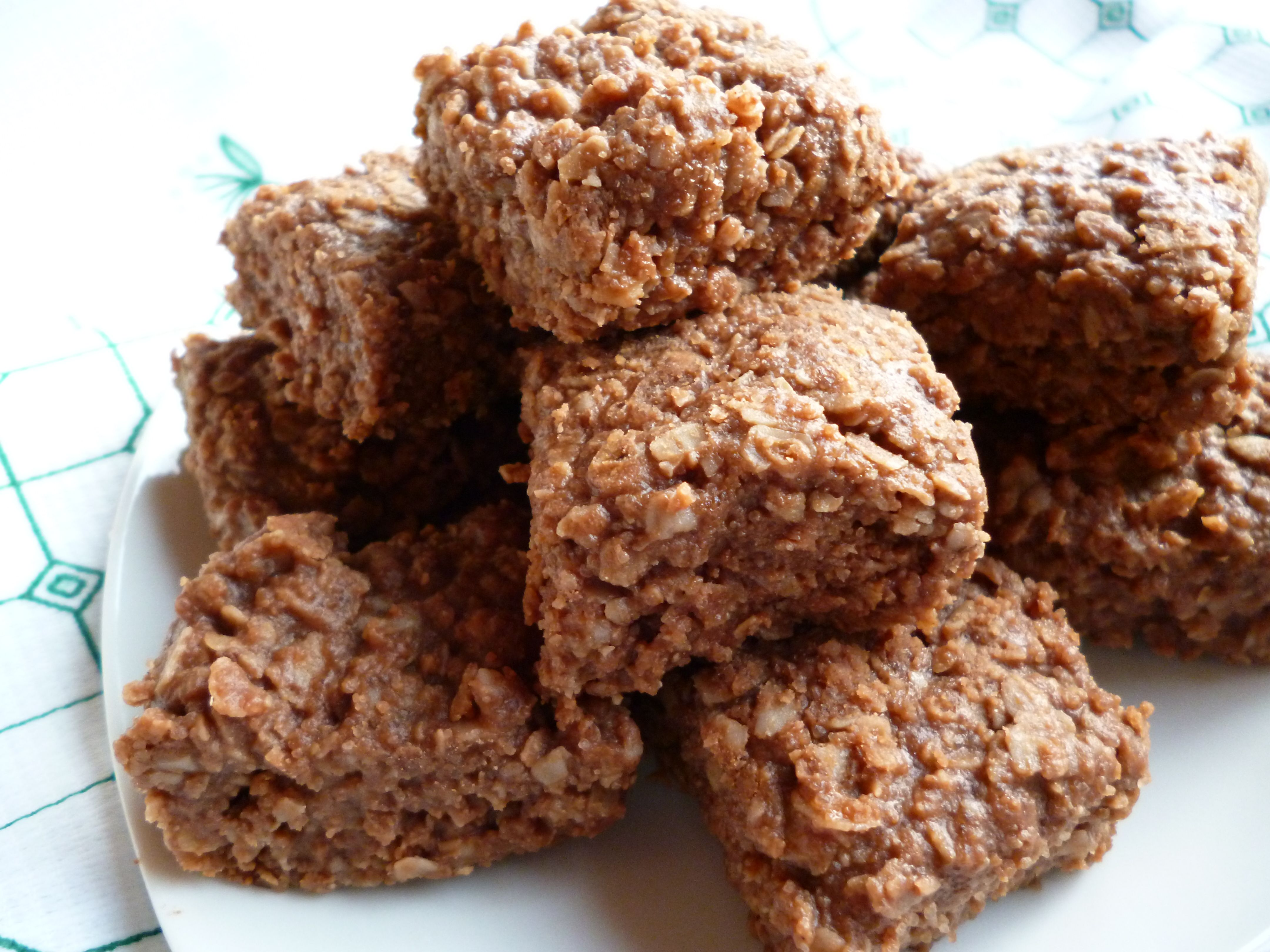 nutella no-bakes   bring 2 c sugar & 1 c butter to a boil on med/high heat. reduce heat and add 1 tsp vanilla, 1/4 tsp salt, 1 c peanut butter, 1 c nutella or generic equiv.  mix/cook 5 min.  add 3 cup oats.  spread in 8in. pan lined with foil. cut when cool.   try not to eat them all yourself