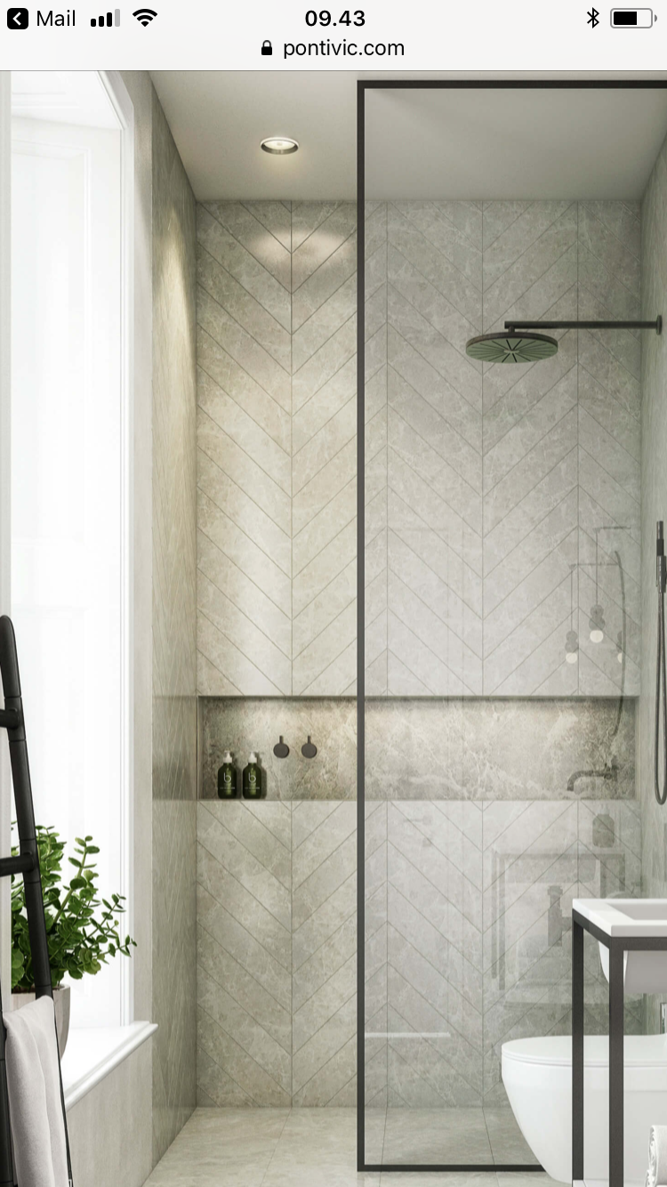Photo of black frame shower partition, horizontal niche, herringbone tile