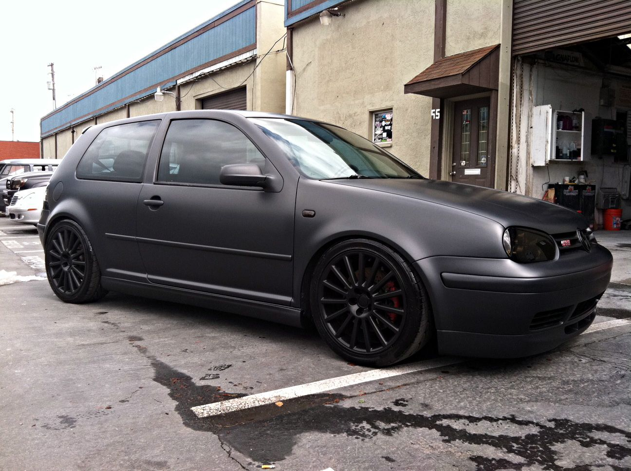 Gti That Just Got Out Of The Booth With A Matte Charcoal