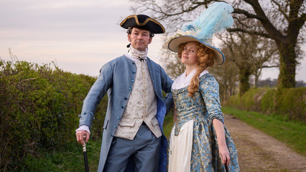 Couple dress in period costumes for lockdown walks in 2020