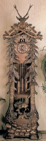 grandfather cuckoo clock. I'm not generally a fan of grandfather clocks - but the artistry and detail on this piece is amazing, and would look great in a kitschy camp home!