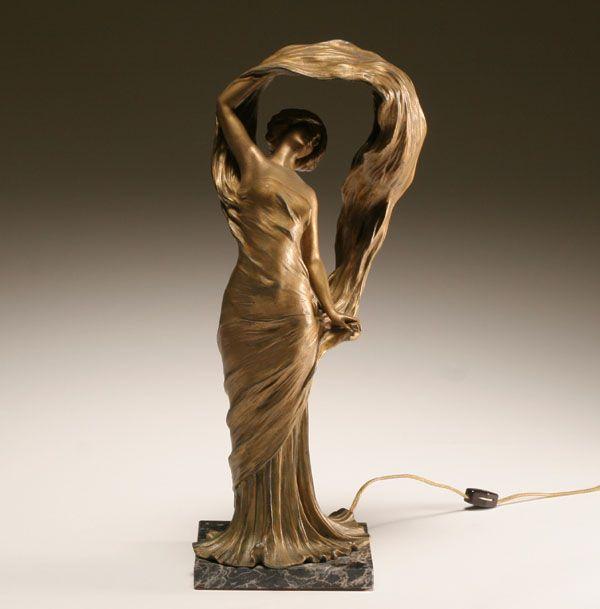 An Art Deco gilt patinated spelter figure, modelled as a