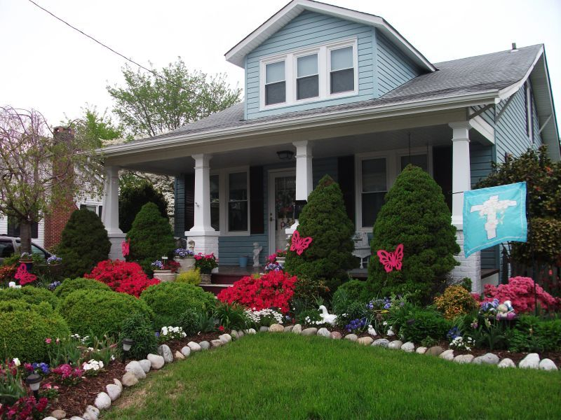 Front yard landscaping with small grass area for a for Pictures of front yard landscapes