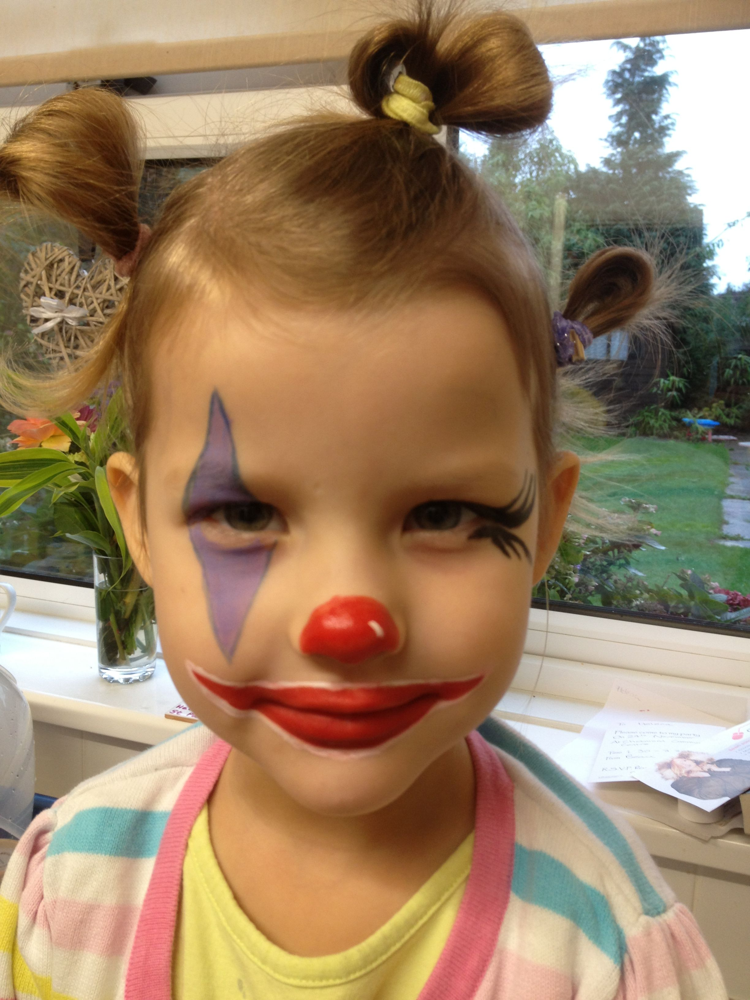 Clown face painting for a beautiful girl