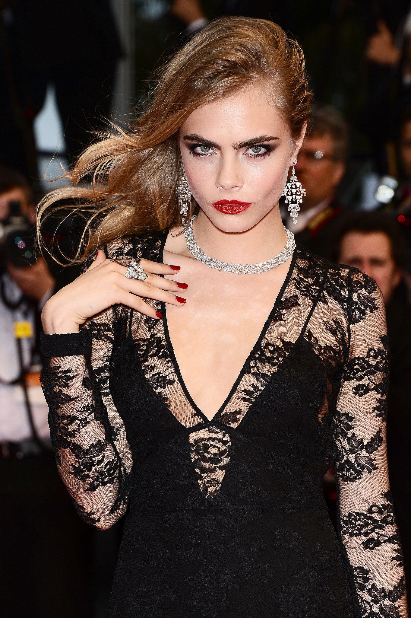 Black dress with red lipstick - Cara Delevingne Matched Her Deep Red Lipstick With A Brick Red Nail Polish For