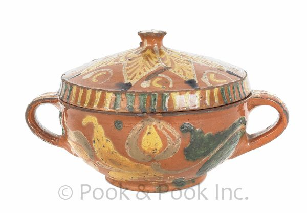 Southeast Pennsylvania redware covered bowl, circa 1800, with extensive slip star and tulip decoration, 5 H. x 8.5 diameter.  You don't see much redware like this.