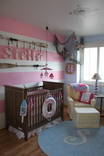 Nautical theme in pinks & blues...perfect for a little girl. don't worry, I don't want kids until I'm like thirty...just saw it and liked it!