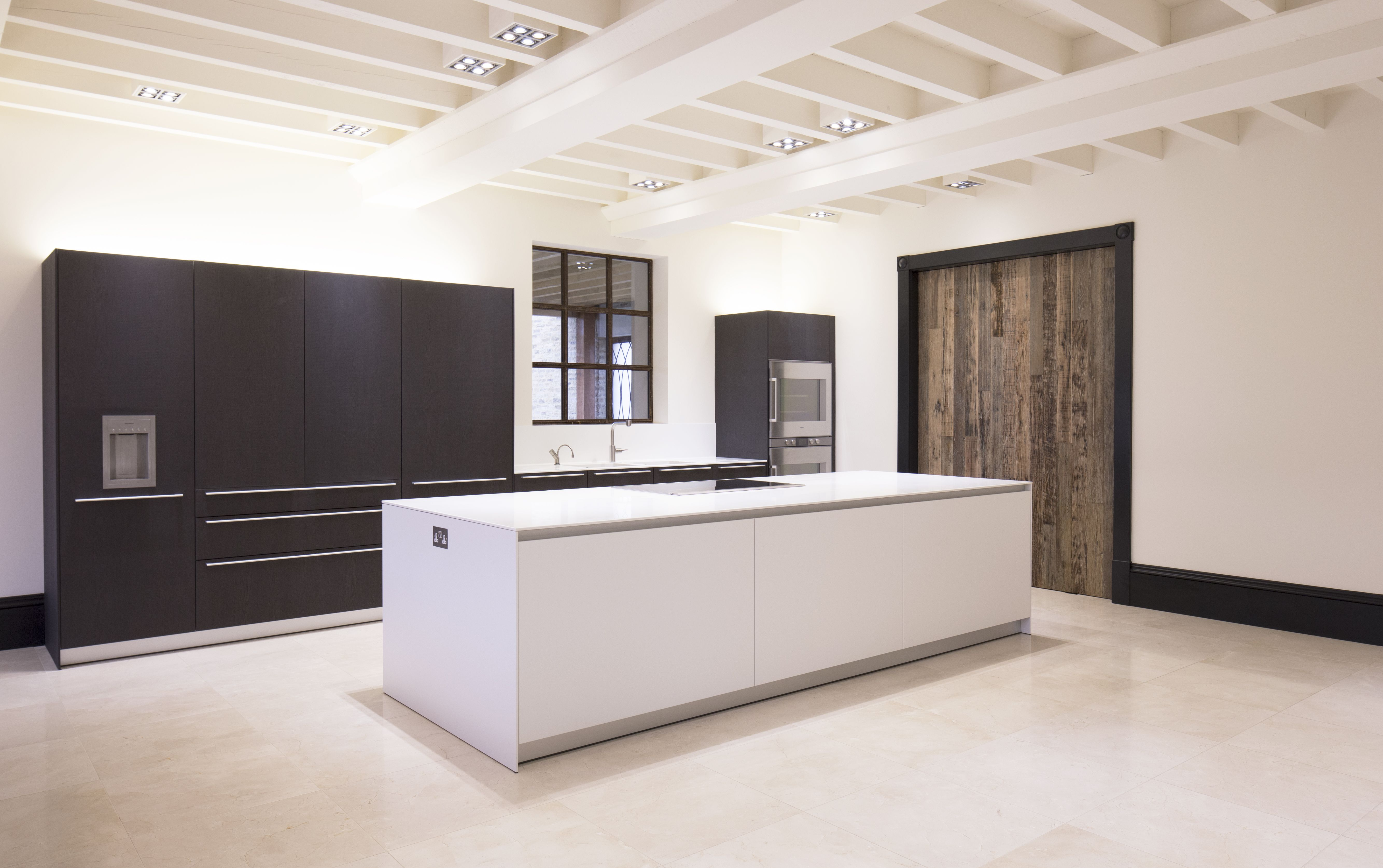 Bulthaup B3 The Large Bulthaup B3 Kitchen Is Created Using Alpine White Laminate For The Island And Dark Stained Oak Venee… | Georgian Style Homes, White Laminate, Luxury Homes
