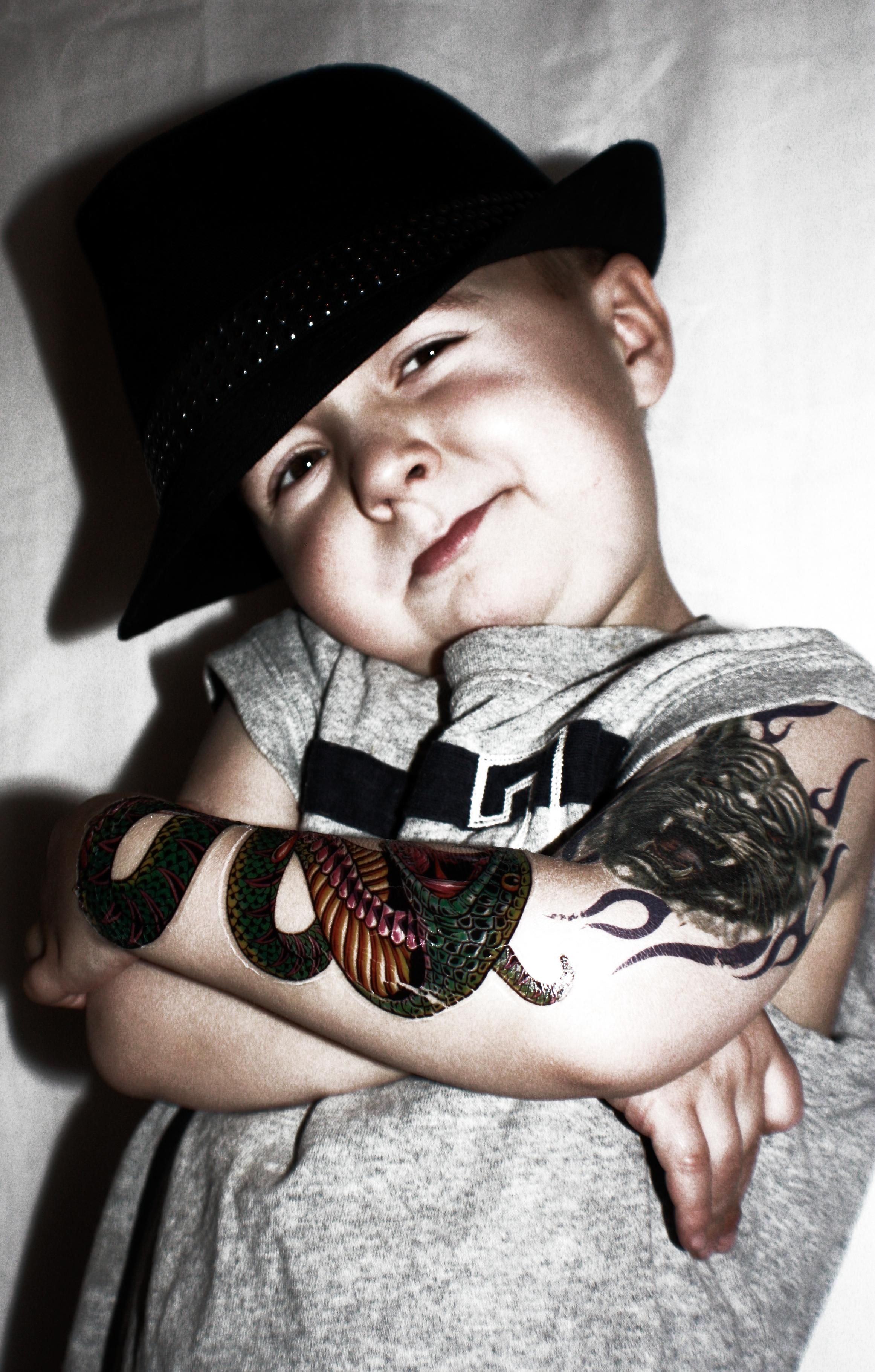 my son dressed up as a bad boy with his stick on tattoos