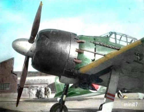 zero fighter in a airfield in japan 1945 (note the 20mm cannon in the wing)