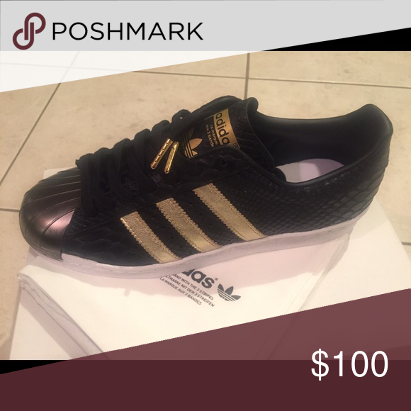 Adidas customize to shell toes. Never been worn. Black leather snake with gold detailing. Size 9 but runs really big size 10 or 10 1/2. Adidas Shoes Sneakers