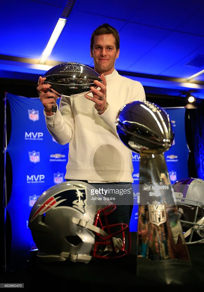 5a3745476f00 Tom Brady of the New England Patriots holds the Super Bowl XLIX MVP trophy  during a Chevrolet Super Bowl XLIX MVP press conference following the  Patriots ...